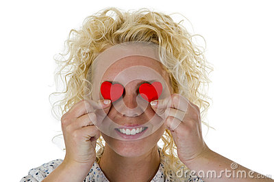 Young woman hiding her eyes with texture hearts