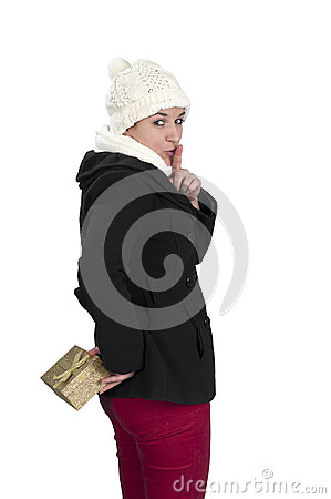 Young woman hiding a present behind her back