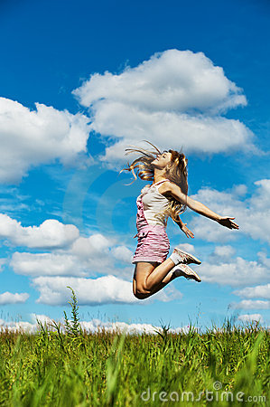Young woman high jumps
