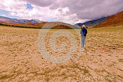 Young woman hiking Altai
