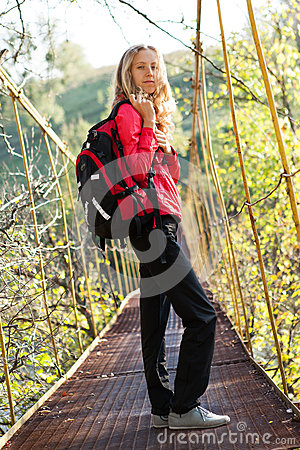 Young woman hiking in suspension bridge