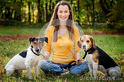 Young woman and his dogs