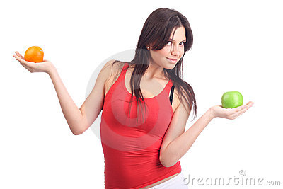 Young woman hold fruit - apple and orange