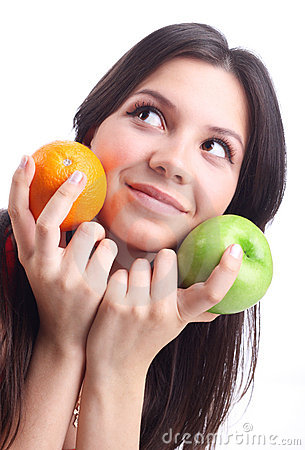 Young woman hold fruit - apple and orange.