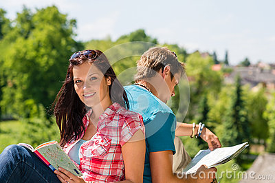 Young woman hold map visit tourist destination