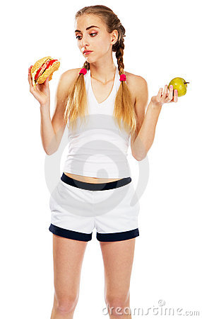 Free Young Woman Holding A Hamburger And An Apple Royalty Free Stock Image - 20252966