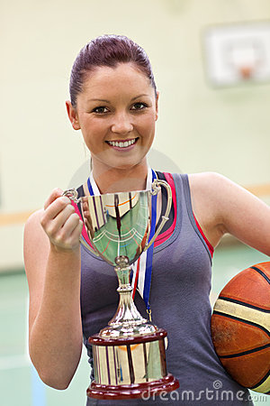 Free Young Woman Holding A Trophy And A Basket Ball Stock Photo - 15970640