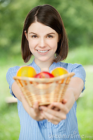 Young woman holding a basket