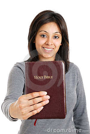 Young woman holding a bible showing commitment