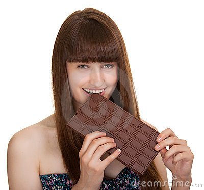 Young woman holding big chocolate bar