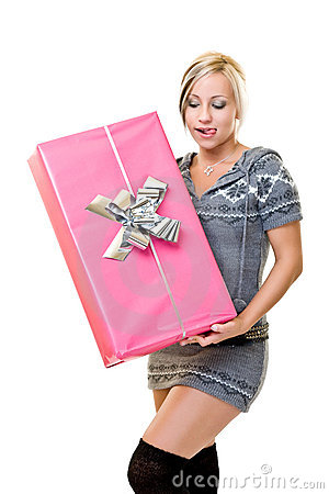 Young woman holding a big pink gift