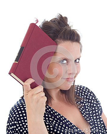 Young woman holding a book to her head