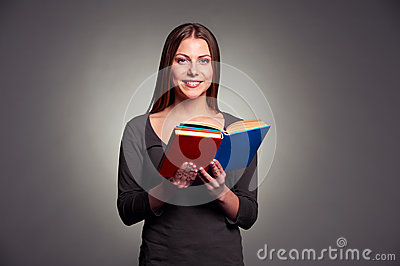 Young woman holding the books