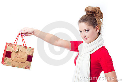 Young woman holding christmas gift bag