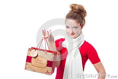Young woman holding christmas gift bag