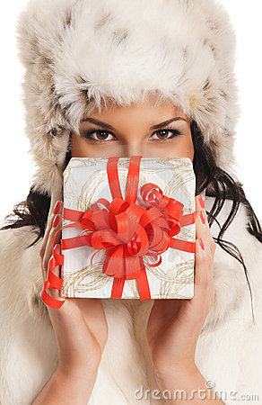 Young woman holding a Christmas present