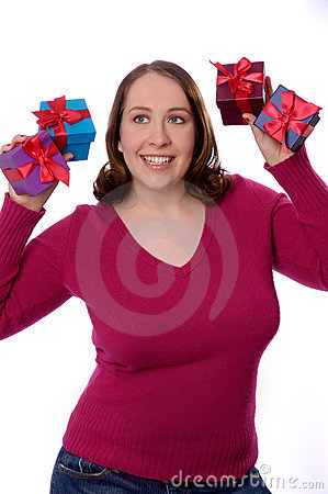 Young woman holding Christmas presents.