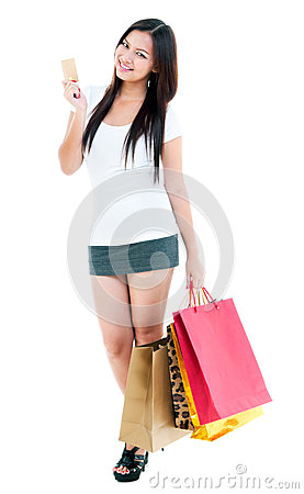 Young Woman Holding Credit Card And Shopping Bags