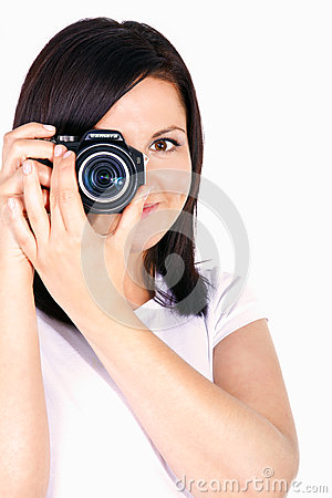 Young woman holding digital camera