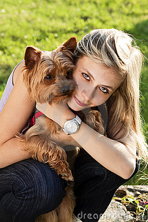 Young woman holding dog