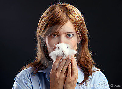 Young woman holding domestic rabbit