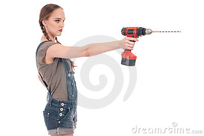Young woman holding drill with auger