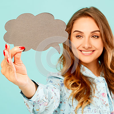 Free Young Woman Holding Empty Thought Bubble Over Blue Background Royalty Free Stock Photo - 98629255
