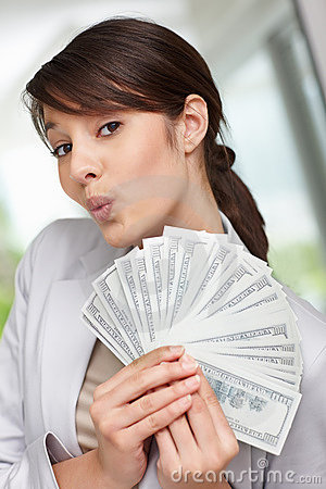 Young woman holding fan of American dollars