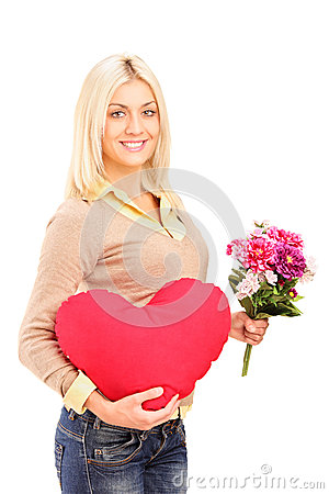 A young woman holding flowers and red heart