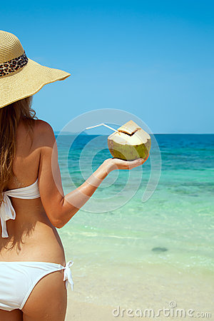 Woman Holding Fresh Coconut At Tropical Beach
