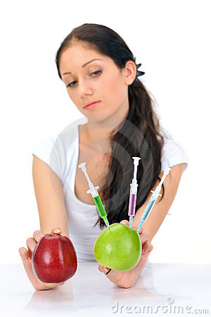 Free Young Woman Holding GMO Apple With Three Syringe Royalty Free Stock Photos - 18423228