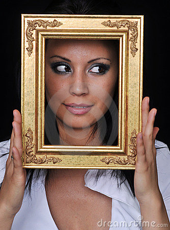 Young woman holding gold antique frame