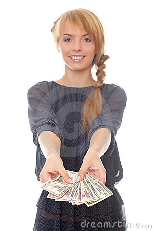 Young woman holding in hand cash money dollars
