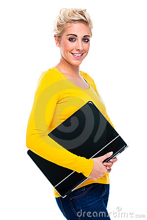 Young Woman Holding her Closed Laptop