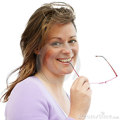 Young woman holding her glasses on white