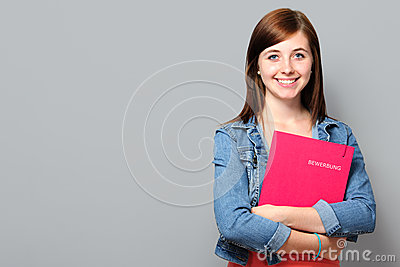 Young woman holding job application