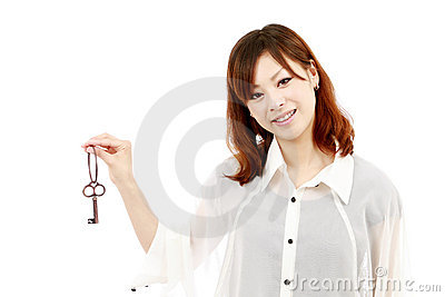 Young woman holding a key