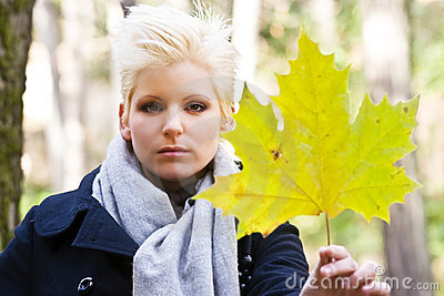 Young woman holding leaf