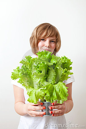 Young woman holding lettuce