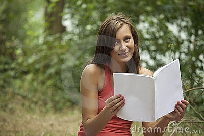 Young woman holding magazine