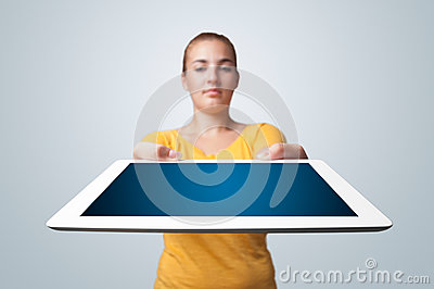 Young woman holding modern tablet