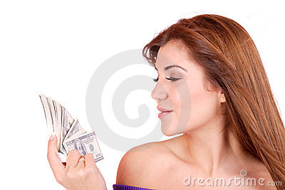 Young woman holding money in the hand