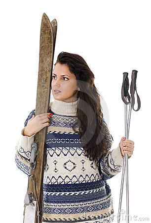 Young woman holding old wooden skis