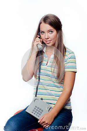 Young woman holding a phone isolated on white