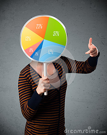Young woman holding a pie chart Stock Photo