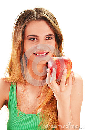 Young woman holding a red ripe apple in her hand
