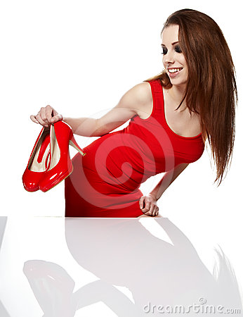 Young woman holding a red shoe