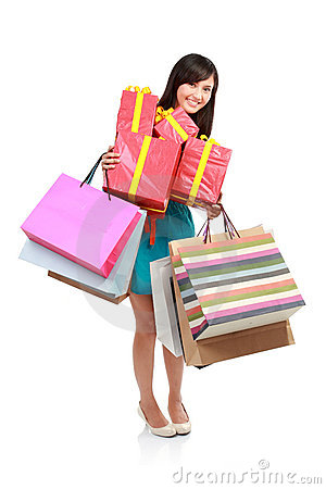 Young woman holding shopping bag and gift box.