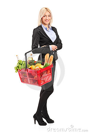 Young woman holding a shopping basket