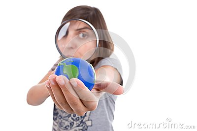 Young woman holding small earth globe